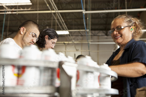 Hispanic people working on assembly line