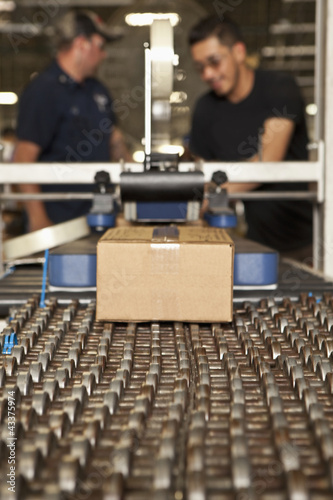 Workers working on assembly line