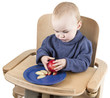 young child eating peaches in high chair