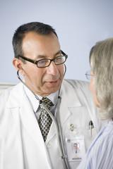 Doctor examining patient
