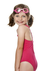 little girl wearing pink swimsuit isolated on white background