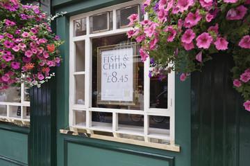 Flowers decorating pub window