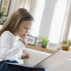 Caucasian girl using laptop