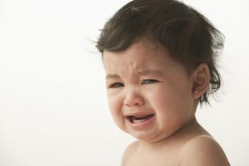 Crying mixed race baby girl