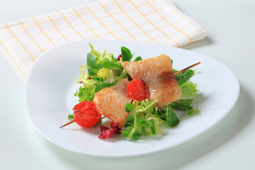 Fish skewer and salad greens