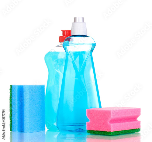 Dishwashing liquids and sponge isolated on white