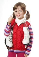 happy little girl with skates on white background
