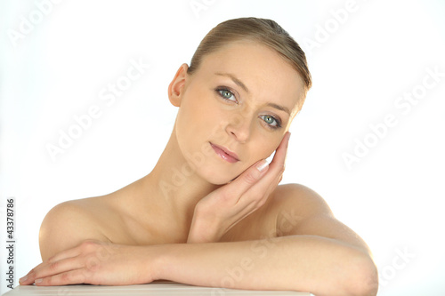 Portrait of a woman stroking her face