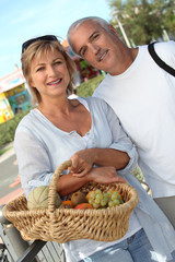 Couple with basket of fruit