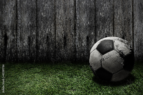 Old football on grass