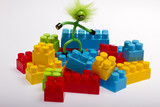 Lego plastic toy blocks with puppet, red, blue, green poster