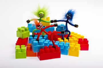 Lego plastic toy blocks with puppet, red, blue, green
