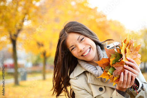 Fall woman playing with leaves