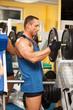 Strong man preparing his training machine