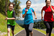 Active family - mother and kids running outdoor - 43382709