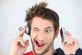 Man holding headphones and mobile telephone