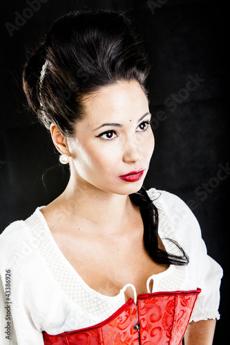 attractive brunette woman isolated on black