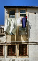 Drying clothes on house window in Coimbra