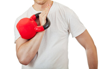 Athlete man holding the red kettlebell