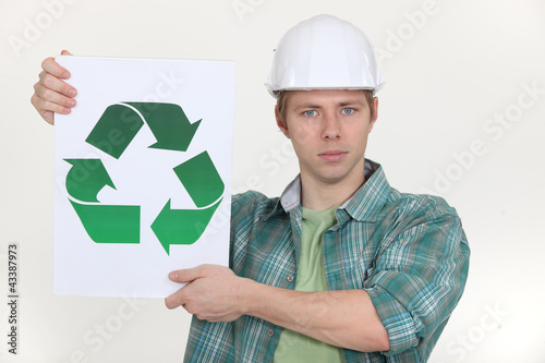 Builder holding the universal recycling symbol