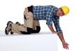 laborer kneeling