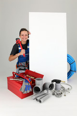 Woman with blank board and toolbox