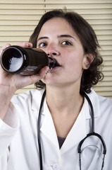 Medical Staff Member drinking beer