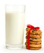 glass of milk and chocolate chips cookies with red ribbon
