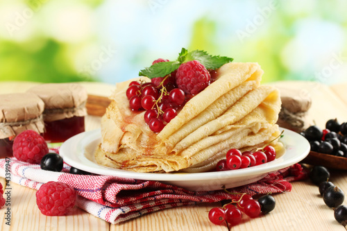 pancakes with berries, jam and honey