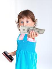 Little girl holds one hundred dollars US