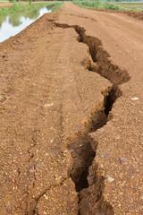 Gravel road in rural split apart.