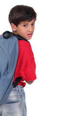 Little boy wearing a rucksack