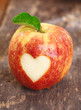 Ripe red apple with heart shape
