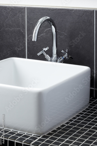 Sink tap in contemporary bathroom