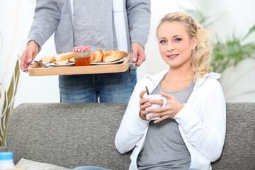 Man serving woman breakfast