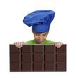 Niño cocinero sujetando una barra de chocolate grande.