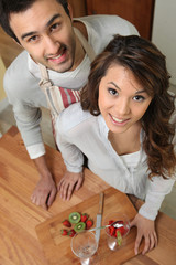 Couple preparing fruit salad