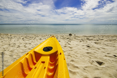 Paddle boats on white sandy beach and blue sea