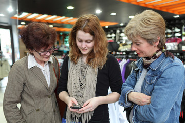 Family in shopping looking to cell phone