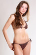 brunette woman in Brown lingerie .