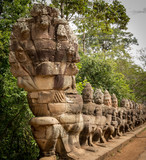Warriors line entrance to south gate angkor thom