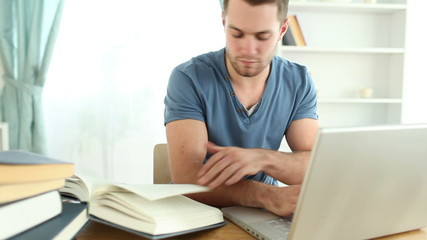 Man doing research with books