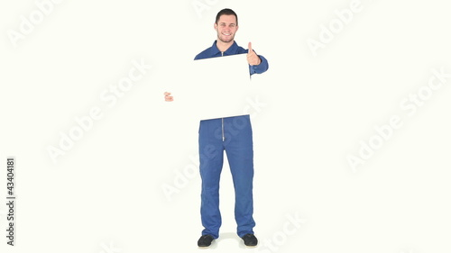Man wearing overall and holding a blank board
