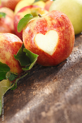 Delicious red apple with heart cutout