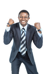 Portrait of an excited businessman with arms raised