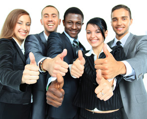 Business group with thumbs up isolated over white