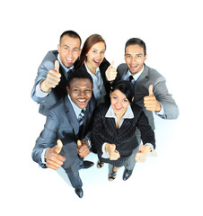 Young group of business people showing thumbs up