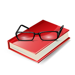 reading glasses on red book