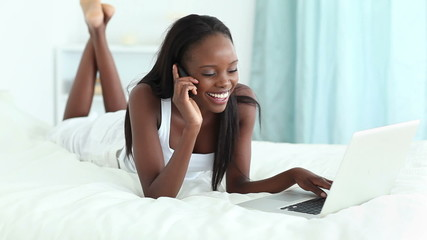 Woman smiling while being on the phone
