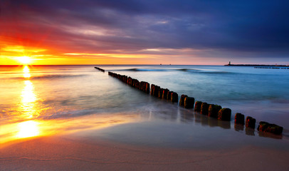 Baltic sea at beautiful sunrise in Poland beach.